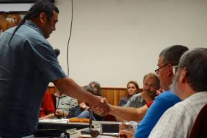 LCO Vice Chair Rusty Barber shakes hands with Iron County Board Chair Joe Pinardi.