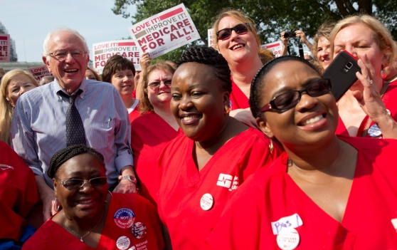 Democratic presidential candidate, Sen. Bernie Sanders, I-Vt., left, poses with a group of nurses after speaking at a rally on the 50th anniversary of Medicare and Medicaid, Thursday, July 30, 2015, on Capitol Hill in Washington. (AP Photo/Jacquelyn Martin)